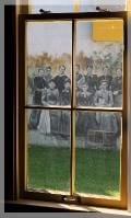 Mural of the Ladies School Aid Society viewed through a window.